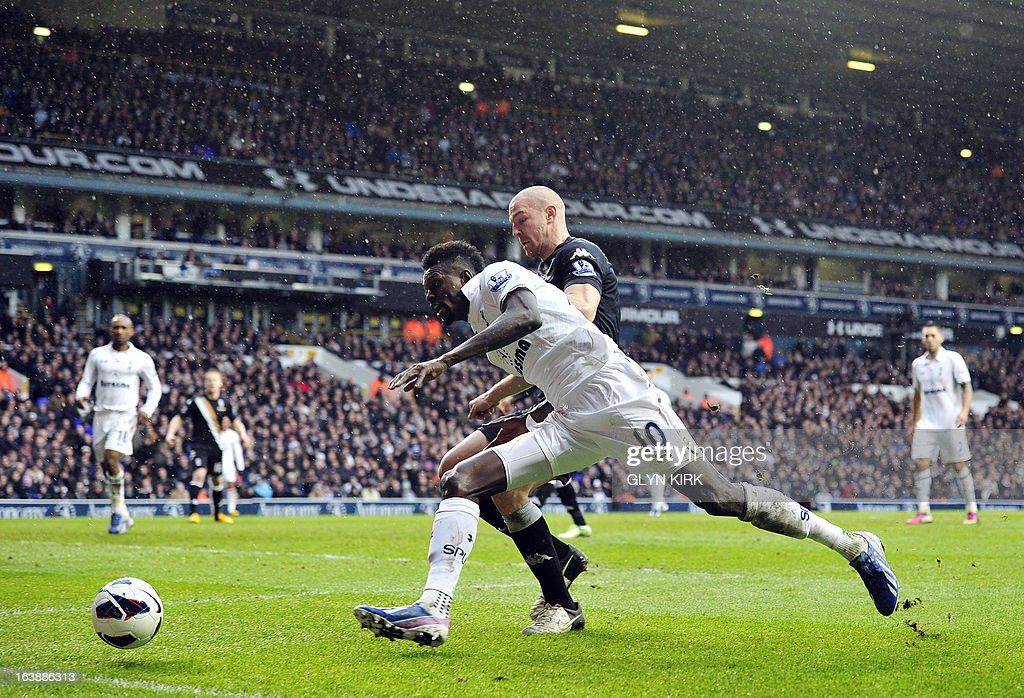 """Tottenham Hotspur's Togolese striker Emmanuel Adebayor (L) vies with Fulham's Swiss defender Philippe Senderos (R) during the English Premier League football match between Tottenham Hotspur and Fulham at White Hart Lane in north London on March 17, 2013. USE. No use with unauthorized audio, video, data, fixture lists, club/league logos or """"live"""" services. Online in-match use limited to 45 images, no video emulation. No use in betting, games or single club/league/player publications"""