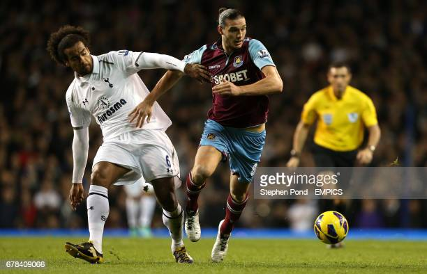Tottenham Hotspur's Tom Huddleston and West Ham United's Andy Carroll fight for the ball