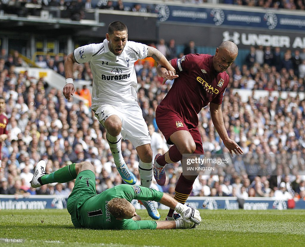 "Tottenham Hotspur's US midfielder Clint Dempsey (2nd L) vies with Manchester City's English goalkeeper Joe Hart (L) and Belgium defender Vincent Kompany (R) during the English Premier League football match between Tottenham Hotspur and Manchester City at White Hart Lane in north London on April 21, 2013. Tottenham won the game 3-1. USE. No use with unauthorized audio, video, data, fixture lists, club/league logos or ""live"" services. Online in-match use limited to 45 images, no video emulation. No use in betting, games or single club/league/player publications"