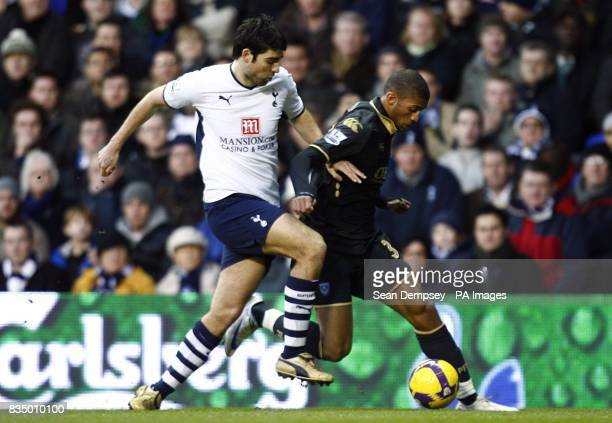 Tottenham Hotspur's Vedran Corluka and Portsmouth's Armand Traore battle for the ball