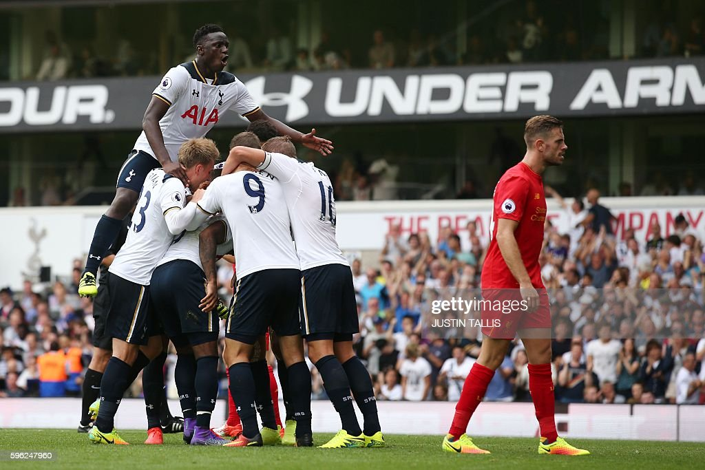 Tottenham Hotspur's Victor Wanyama jumps onto teammates as they celebrate a goal by English defender Danny Rose during the English Premier League football match between Tottenham Hotspur and Liverpool at White Hart Lane in London, on August 27, 2016. / AFP / JUSTIN TALLIS / RESTRICTED TO EDITORIAL USE. No use with unauthorized audio, video, data, fixture lists, club/league logos or 'live' services. Online in-match use limited to 75 images, no video emulation. No use in betting, games or single club/league/player publications. /
