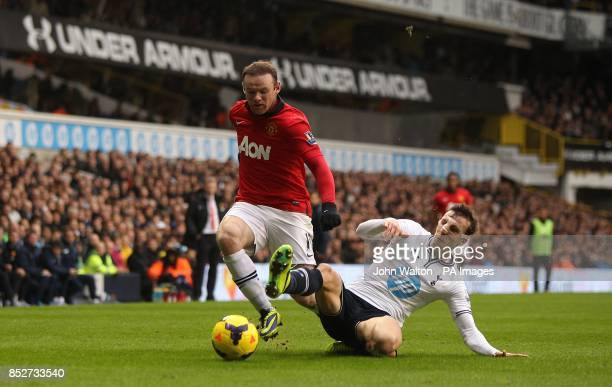 Tottenham Hotspur's Vlad Chiriches and Manchester United's Wayne Rooney battle for the ball