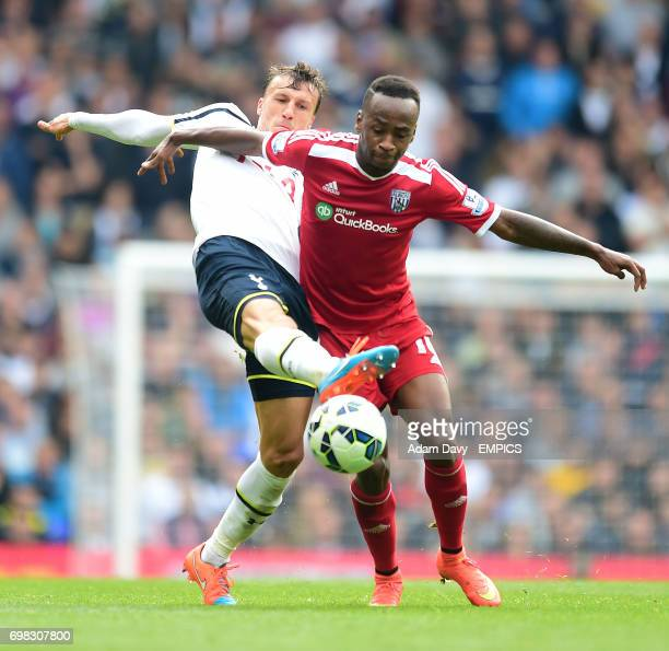 Tottenham Hotspur's Vlad Chiriches and West Bromwich Albion's Saido Berahino battle for the ball
