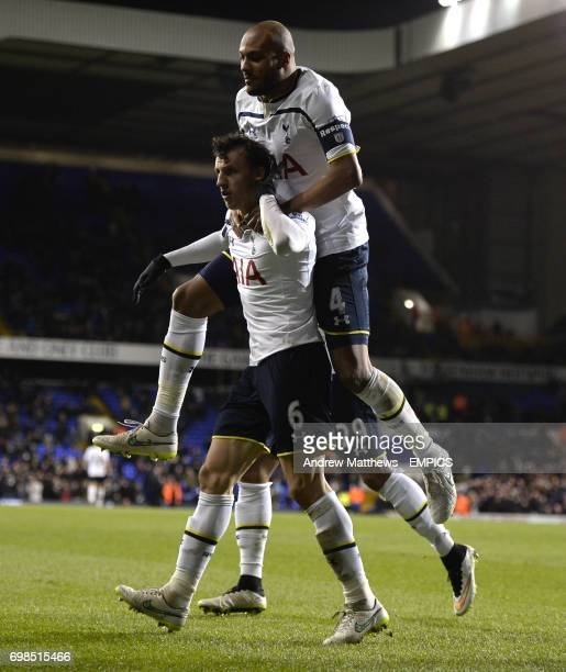 Tottenham Hotspur's Vlad Chiriches celebrates with team mate Younes Kaboul after he heads homes their side's third goal of the game