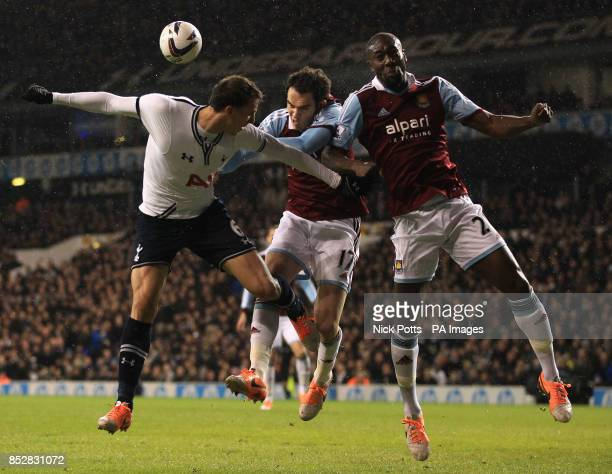 Tottenham Hotspur's Vlad Chiriches goes for header with West Ham United's Joey O'Brien and Carlton Cole during the Capital One Cup match at White...