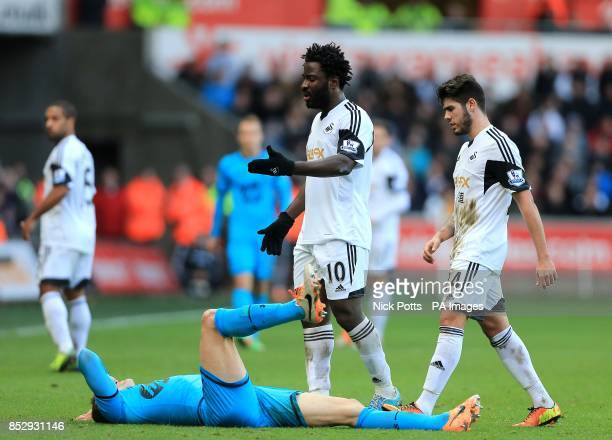 Tottenham Hotspur's Vlad Chiriches lies on the pitch after a foul from Swansea City's Wilfried Bony