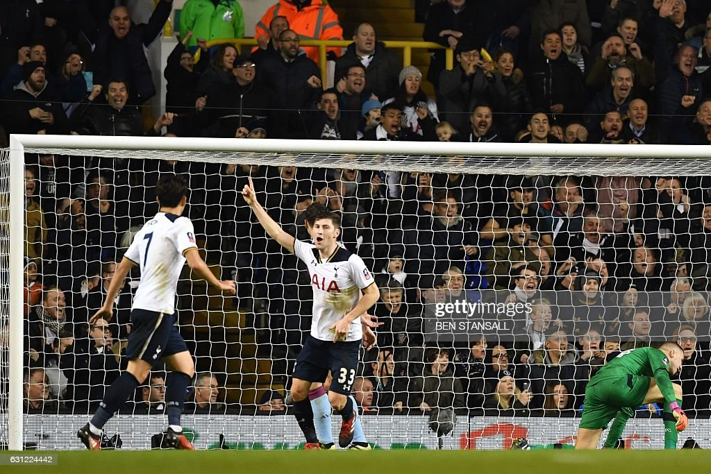Tottenham Hotspur's Welsh defender Ben Davies (C) celebrates after scoring the opening goal of the English FA Cup third round football match between Tottenham Hotspur and Aston Villa at White Hart Lane in London, on January 8, 2017. / AFP / Ben STANSALL / RESTRICTED TO EDITORIAL USE. No use with unauthorized audio, video, data, fixture lists, club/league logos or 'live' services. Online in-match use limited to 75 images, no video emulation. No use in betting, games or single club/league/player publications. /