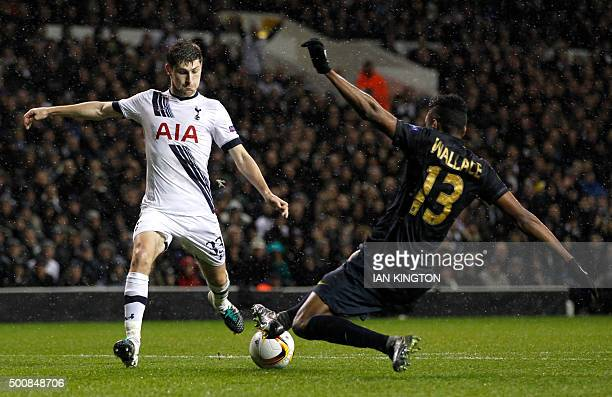 Tottenham Hotspur's Welsh defender Ben Davies has a shot on goal by Monaco's Brazilian defender Fortuna Dos Santos Wallace during the UEFA Europa...