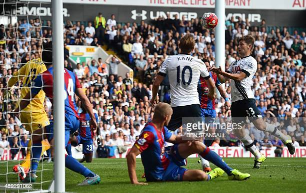 Tottenham Hotspur's Welsh defender Ben Davies heads into the net but the goal is disallowed for offside during the English Premier League football...