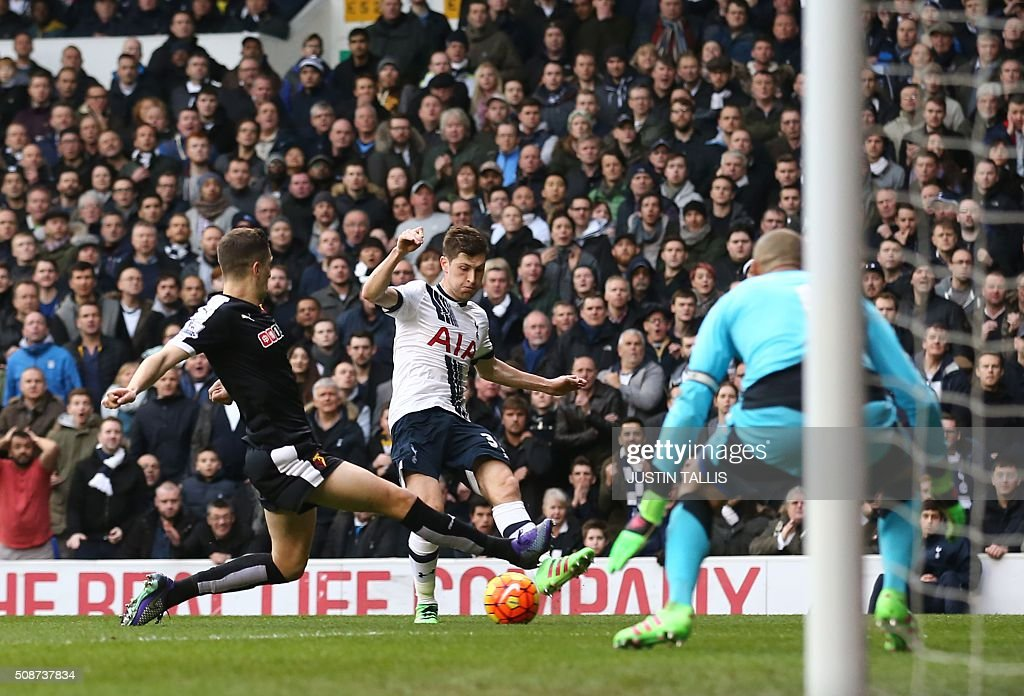 Tottenham Hotspur's Welsh defender Ben Davies (C) is tackled by Watford's Northern Irish defender Craig Cathcart controls the ball during the English Premier League football match between Tottenham Hotspur and Watford at White Hart Lane in north London on February 6, 2016. / AFP / JUSTIN TALLIS / RESTRICTED TO EDITORIAL USE. No use with unauthorized audio, video, data, fixture lists, club/league logos or 'live' services. Online in-match use limited to 75 images, no video emulation. No use in betting, games or single club/league/player publications. /