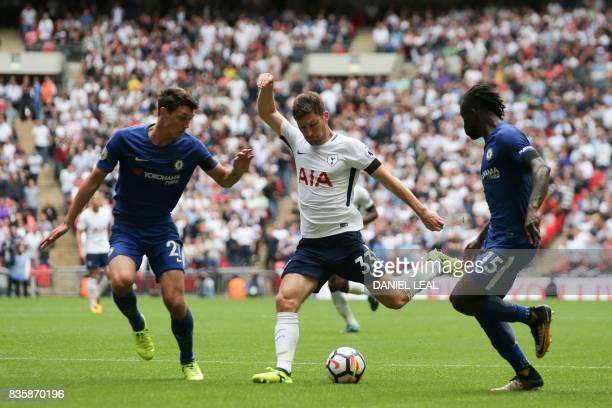 Tottenham Hotspur's Welsh defender Ben Davies plays the ball between Chelsea's Danish defender Andreas Christensen and Chelsea's Nigerian midfielder...