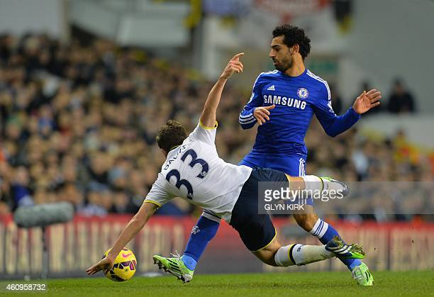 Tottenham Hotspur's Welsh defender Ben Davies vies with Chelsea's Egyptian midfielder Mohamed Salah during the English Premier League football match...