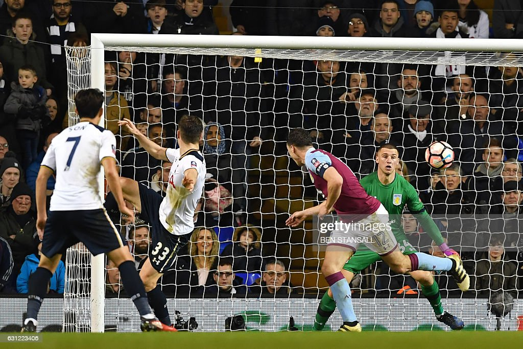 Tottenham Hotspur's Welsh defender Ben Davies (2nd L) watches his header beat Aston Villa's English goalkeeper Sam Johnstone (R) for the opening goal of the English FA Cup third round football match between Tottenham Hotspur and Aston Villa at White Hart Lane in London, on January 8, 2017. / AFP / Ben STANSALL / RESTRICTED TO EDITORIAL USE. No use with unauthorized audio, video, data, fixture lists, club/league logos or 'live' services. Online in-match use limited to 75 images, no video emulation. No use in betting, games or single club/league/player publications. /