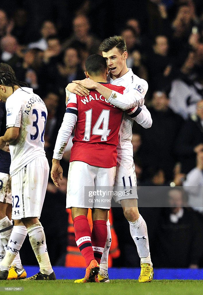 "Tottenham Hotspur's Welsh defender Gareth Bale (R) hugs Arsenal's English striker Theo Walcott (L) after winning the English Premier League football match against Arsenal at White Hart Lane in north London on March 3, 2013. Tottenham Hotspur won the match 2-1. USE. No use with unauthorized audio, video, data, fixture lists, club/league logos or ""live"" services. Online in-match use limited to 45 images, no video emulation. No use in betting, games or single club/league/player publications"