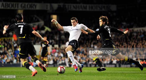 Tottenham Hotspur's Welsh defender Gareth Bale vies with Bolton Wanderers' Spanish defender Marcos Alonso during their FA Cup quarter final replay...