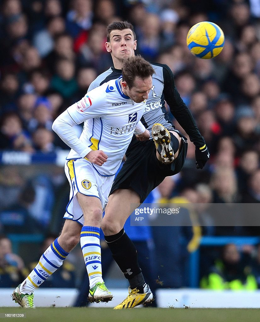 "Tottenham Hotspur's Welsh defender Gareth Bale (R) vies with Leeds United's Irish defender Aidy White during the FA Cup football match between Leeds United and Tottenham Hotspur at Elland road stadium in Leeds, northern England on January 27, 2013. AFP PHOTO/ANDREW YATES. RESTRICTED TO EDITORIAL USE. No use with unauthorized audio, video, data, fixture lists, club/league logos or ""live"" services. Online in-match use limited to 45 images, no video emulation. No use in betting, games or single club/league/player publications."