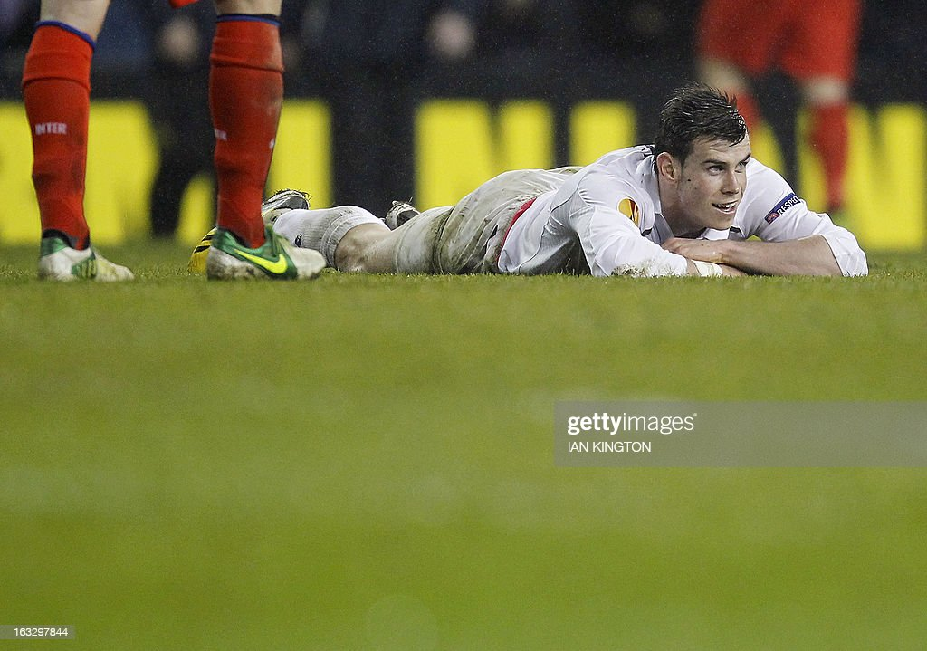Tottenham Hotspur's Welsh footballer Gareth Bale lies on the ground at the end of the game during a UEFA Europa League Round of 16 football match between Tottenham Hotspur and Inter Milan at White Hart Lane in east London, on March 7, 2013.