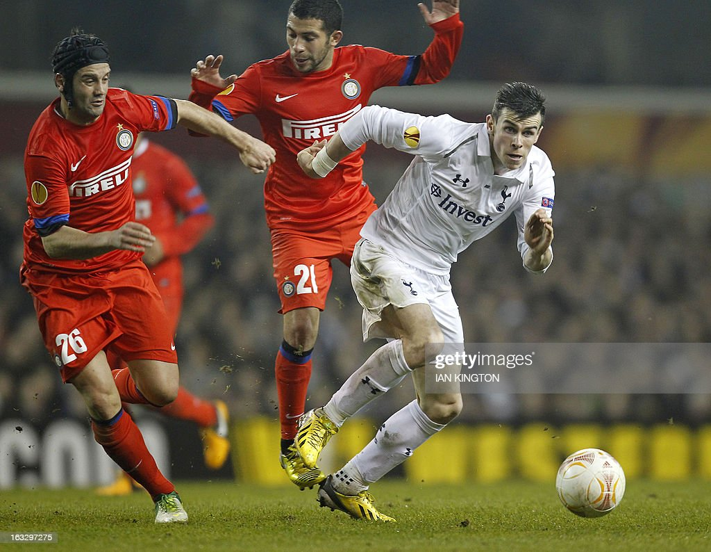Tottenham Hotspur's Welsh footballer Gareth Bale (R) vies for the ball against Inter Milan's Romanian defender Christian Chivu (L) and Inter Milan's Uruguayan midfielder Walter Gargano (2nd L) during a UEFA Europa League Round of 16 football match between Tottenham Hotspur and Inter Milan at White Hart Lane in east London, on March 7, 2013.