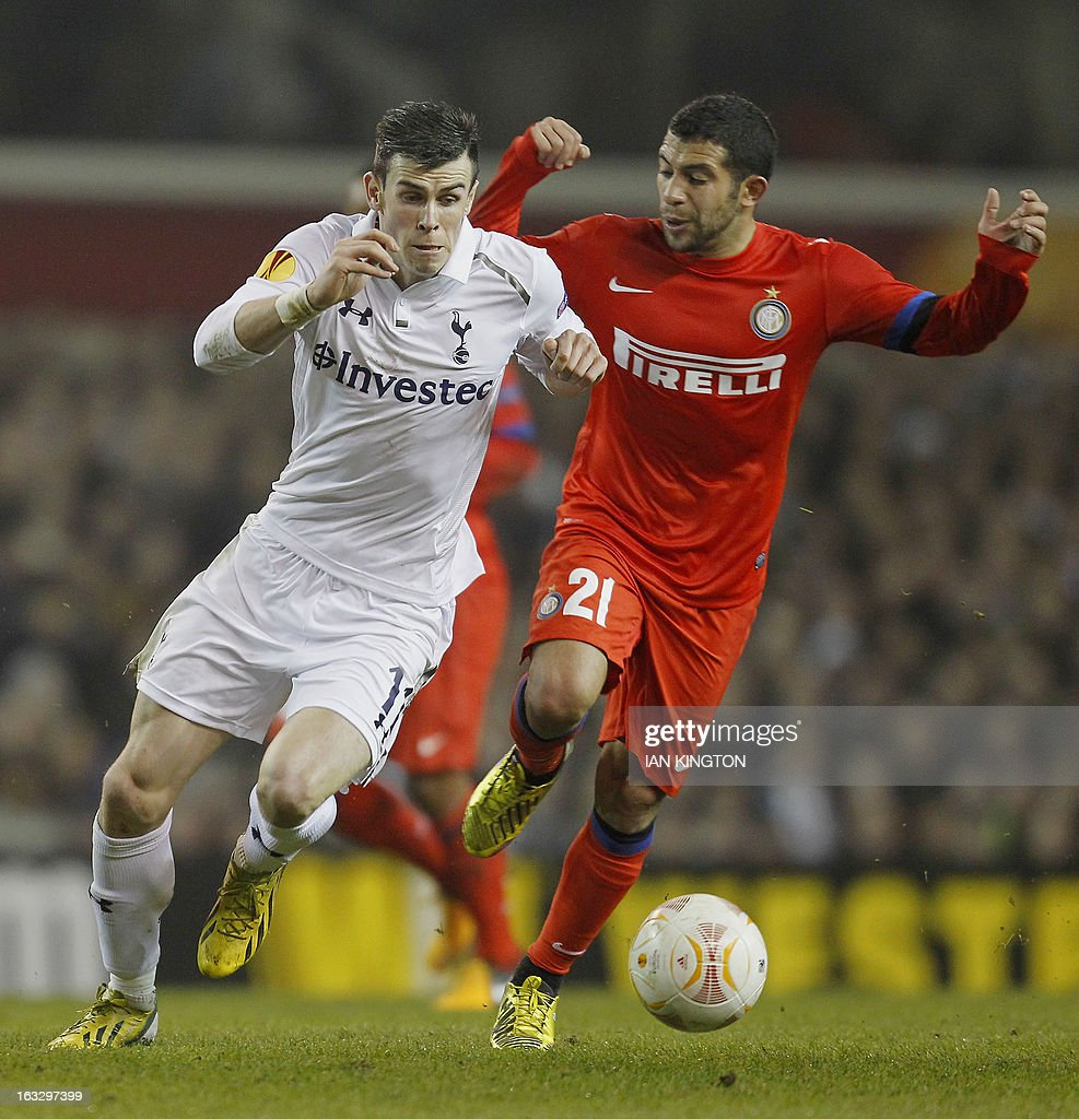 Tottenham Hotspur's Welsh footballer Gareth Bale (L) vies for the ball against Inter Milan's Uruguayan midfielder Walter Gargano during a UEFA Europa League Round of 16 football match between Tottenham Hotspur and Inter Milan at White Hart Lane in east London, on March 7, 2013.
