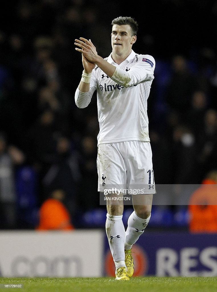 Tottenham Hotspur's Welsh midfielder Gareth Bale applauds the supporters at the final whistle during the Europa League Round of 32 football match between Tottenham Hotspur and Lyon at White Hart Lane in London, England, on February 14, 2013. Tottenham Hotspur won 2-1.