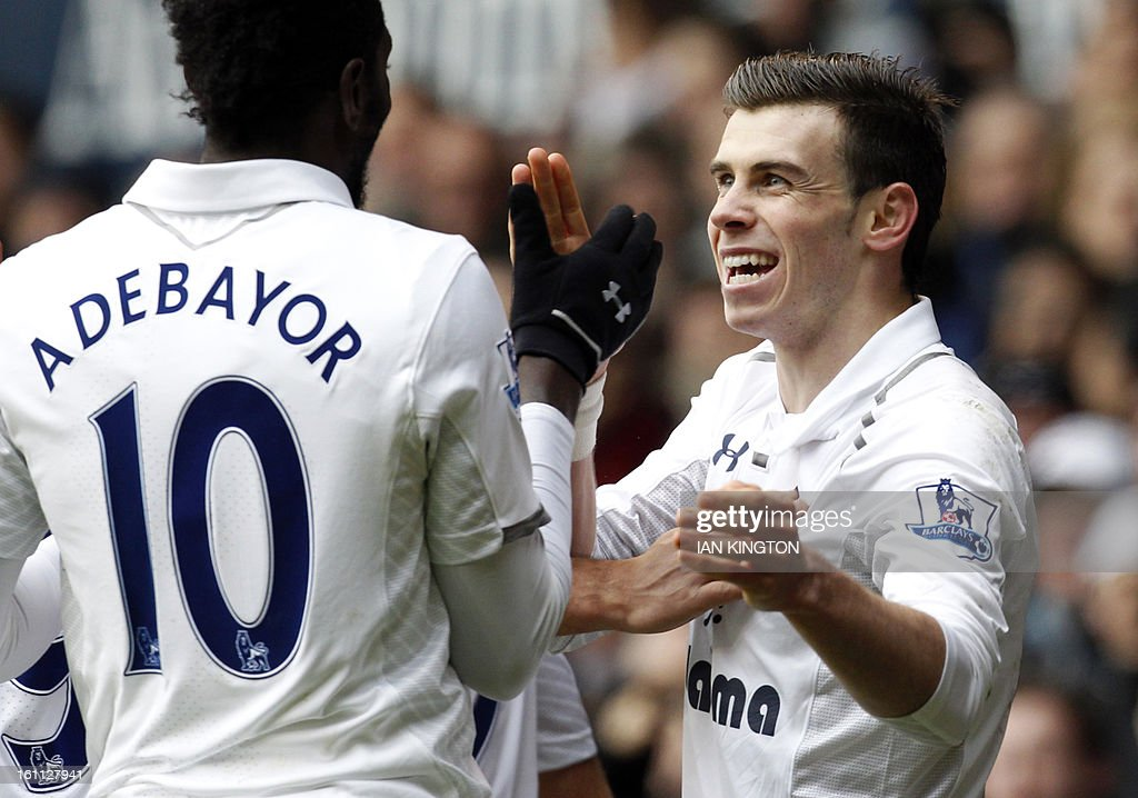 Tottenham Hotspur's Welsh midfielder Gareth Bale celebrates scoring his second goal with Tottenham Hotspur's Togolese striker Emmanuel Adebayor (L) during the English Premier League football match between Tottenham Hotspur and Newcastle United at White Hart Lane in London on February 9, 2013. Tottenham won 2-1. USE. No use with unauthorised audio, video, data, fixture lists, club/league logos or 'live' services. Online in-match use limited to 45 images, no video emulation. No use in betting, games or single club/league/player publications.