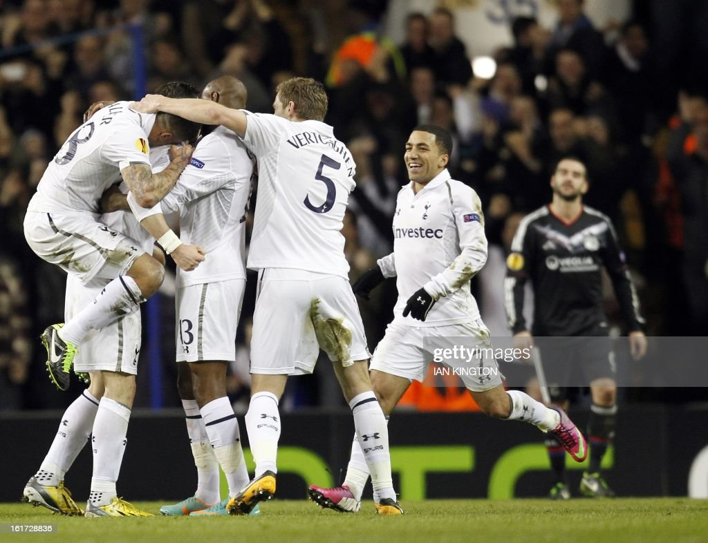 Tottenham Hotspur's Welsh midfielder Gareth Bale (C) celebrates scoring his goal during the Europa League Round of 32 football match between Tottenham Hotspur and Lyon at White Hart Lane in London, England, on February 14, 2013.