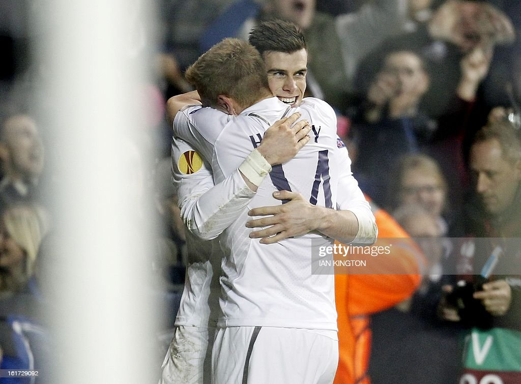 Tottenham Hotspur's Welsh midfielder Gareth Bale (L) celebrates scoring his second goal with Tottenham Hotspur's German midfielder Lewis Holtby during the Europa League Round of 32 football match between Tottenham Hotspur and Lyon at White Hart Lane in London, England, on February 14, 2013. Tottenham Hotspur won 2-1.