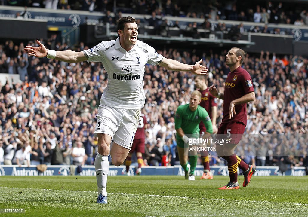"Tottenham Hotspur's Welsh midfielder Gareth Bale celebrates scoring their third goal during the English Premier League football match between Tottenham Hotspur and Manchester City at White Hart Lane in north London on April 21, 2013. Tottenham won the game 3-1. AFP PHOTO / IAN KINGTON USE. No use with unauthorized audio, video, data, fixture lists, club/league logos or ""live"" services. Online in-match use limited to 45 images, no video emulation. No use in betting, games or single club/league/player publications"