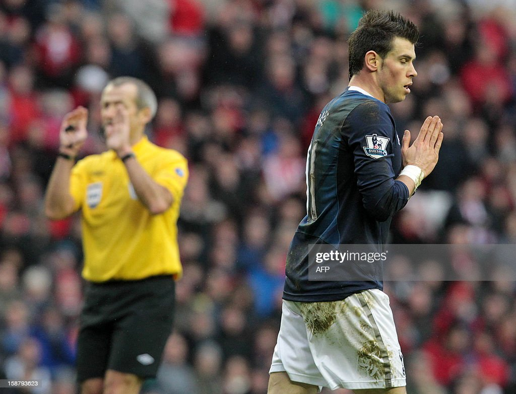 "Tottenham Hotspur's Welsh midfielder Gareth Bale (R) reacts after missing a chance as referee Martin Atkinson (L) gestures during the English Premier League football match between Sunderland and Tottenham Hotspur at The Stadium of Light in Sunderland, north-east England on December 29, 2012. Tottenham Hotspur won the game 2-1. USE. No use with unauthorized audio, video, data, fixture lists, club/league logos or ""live"" services. Online in-match use limited to 45 images, no video emulation. No use in betting, games or single club/league/player publications."