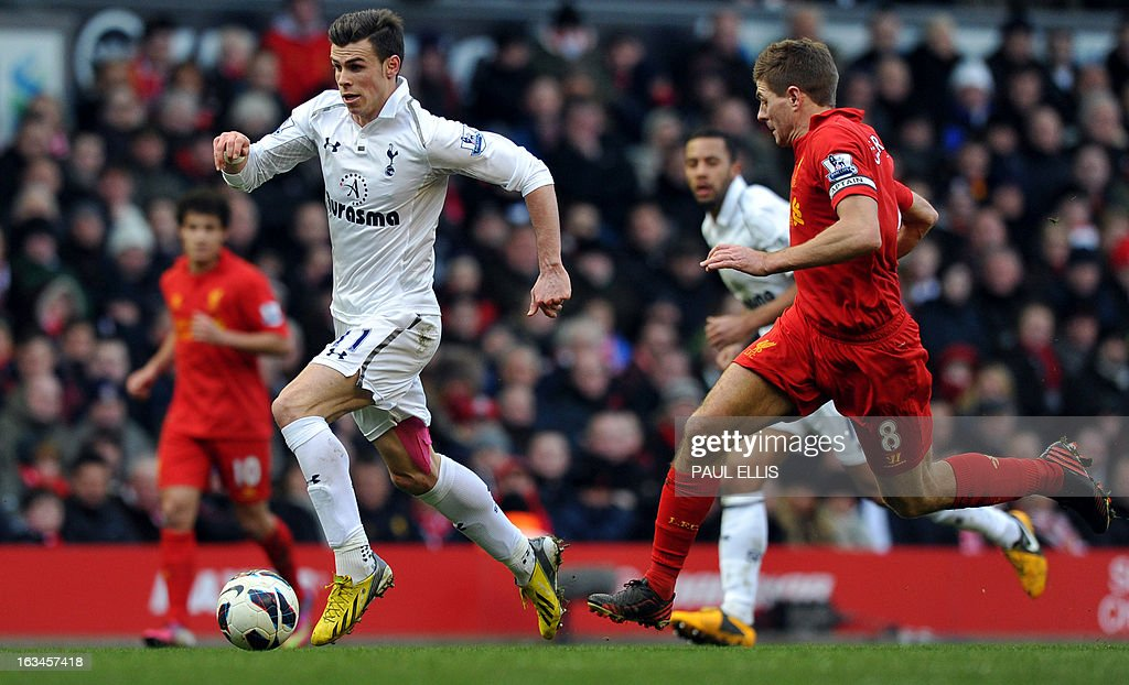 """Tottenham Hotspur's Welsh midfielder Gareth Bale (2nd L) runs with the ball during the English Premier League football match between Liverpool and Tottenham Hotspur at Anfield stadium in Liverpool, northwest England, on March 10, 2013. USE. No use with unauthorized audio, video, data, fixture lists, club/league logos or """"live"""" services. Online in-match use limited to 45 images, no video emulation. No use in betting, games or single club/league/player publications."""