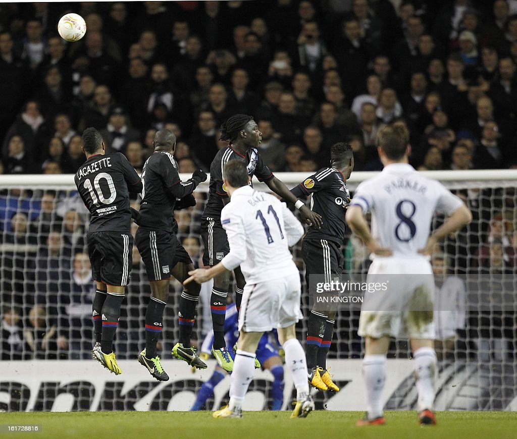 Tottenham Hotspur's Welsh midfielder Gareth Bale (L) scores his goal during the Europa League Round of 32 football match between Tottenham Hotspur and Lyon at White Hart Lane in London, England, on February 14, 2013.