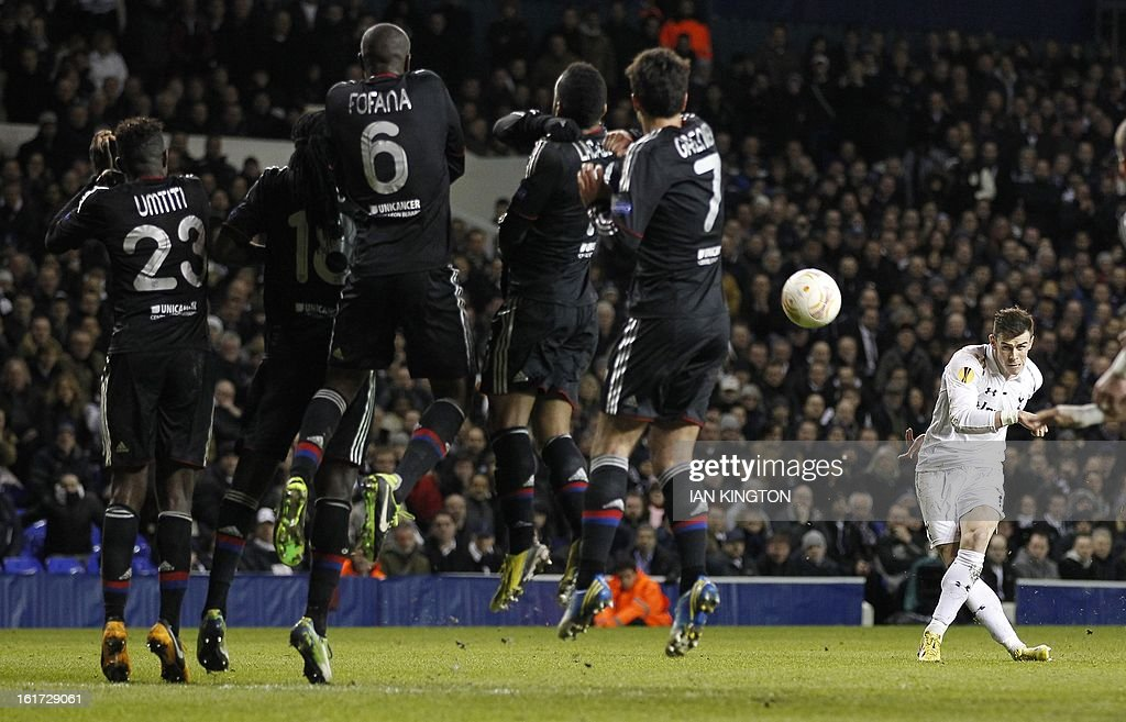 Tottenham Hotspur's Welsh midfielder Gareth Bale (R) shoots to score his second goal during the Europa League Round of 32 football match between Tottenham Hotspur and Lyon at White Hart Lane in London, England, on February 14, 2013. Tottenham Hotspur won 2-1.