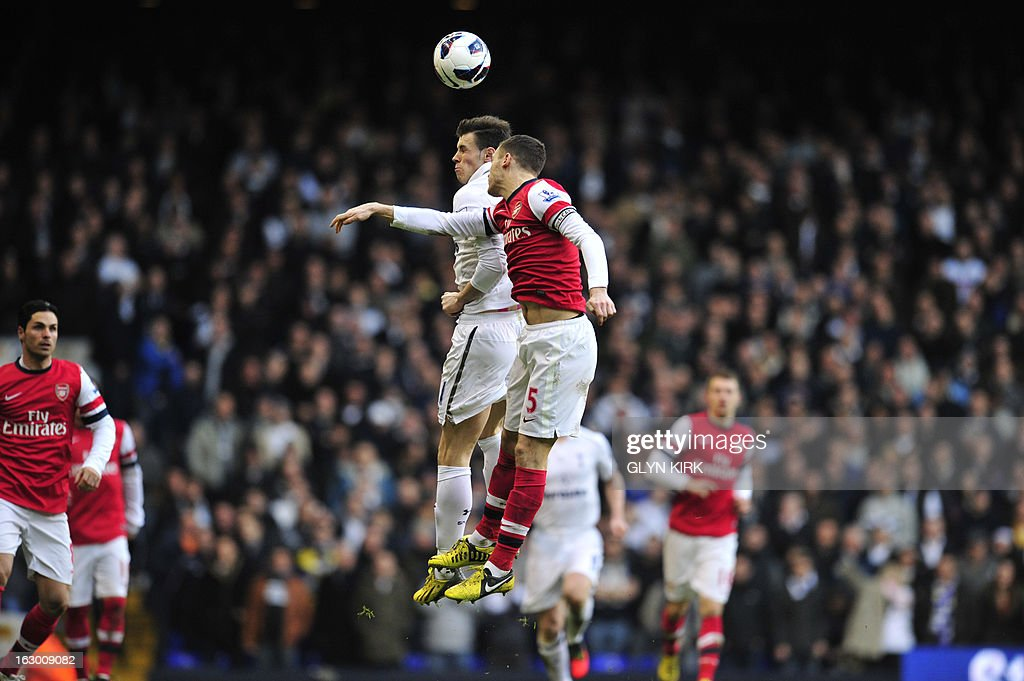 "Tottenham Hotspur's Welsh midfielder Gareth Bale (L) vies with Arsenal's Belgian defender Thomas Vermaelen during the English Premier League football match between Tottenham Hotspur and Arsenal at White Hart Lane in north London on March 3, 2013. USE. No use with unauthorized audio, video, data, fixture lists, club/league logos or ""live"" services. Online in-match use limited to 45 images, no video emulation. No use in betting, games or single club/league/player publications"