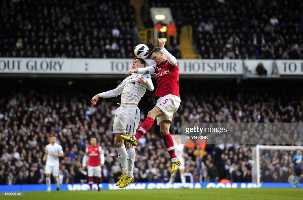 "Tottenham Hotspur's Welsh midfielder Gareth Bale (L) vies with Arsenal's Belgian defender Thomas Vermaelen (R) during the English Premier League football match between Tottenham Hotspur and Arsenal at White Hart Lane in north London on March 3, 2013. AFP PHOTO/GLYN KIRK USE. No use with unauthorized audio, video, data, fixture lists, club/league logos or ""live"" services. Online in-match use limited to 45 images, no video emulation. No use in betting, games or single club/league/player publications"