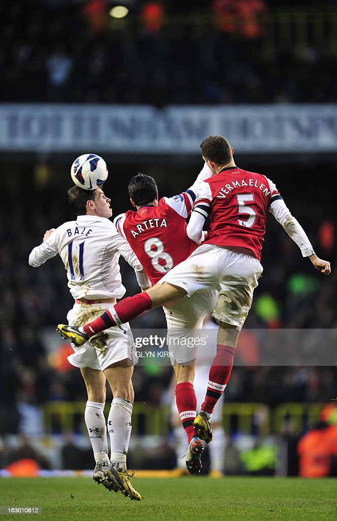 "Tottenham Hotspur's Welsh midfielder Gareth Bale (L) vies with Arsenal's Belgian defender Thomas Vermaelen (R) and Spanish midfielder Mikel Arteta (2nd L) during the English Premier League football match between Tottenham Hotspur and Arsenal at White Hart Lane in north London on March 3, 2013. USE. No use with unauthorized audio, video, data, fixture lists, club/league logos or ""live"" services. Online in-match use limited to 45 images, no video emulation. No use in betting, games or single club/league/player publications"