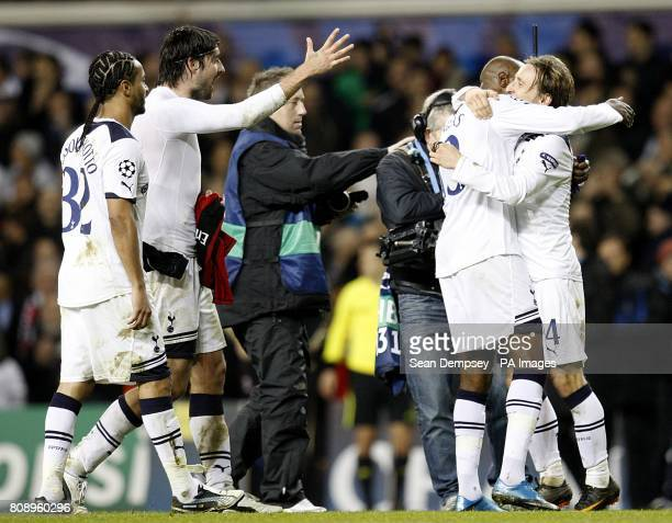 Tottenham Hotspur's William Gallas and Luka Modric hug as they celebrate with teammates winning the tie after the final whistle