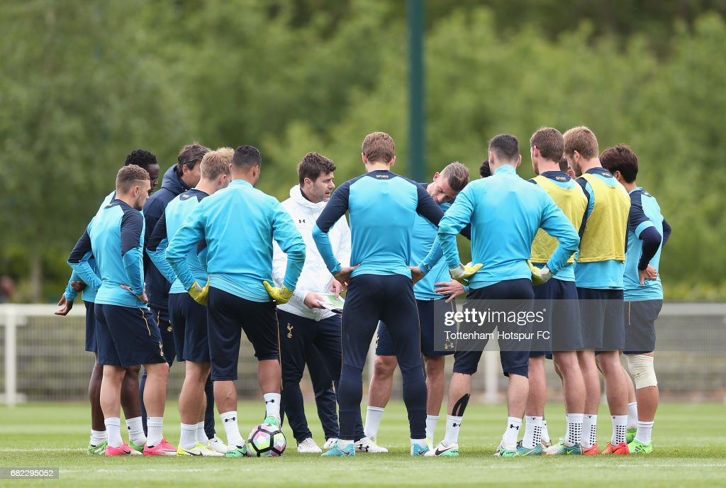 Tottenham manager Mauricio Pochettino talks to his players during the Tottenham Hotspur training session at Tottenham Hotspur Training Centre on May 12, 2017 in Enfield, England.