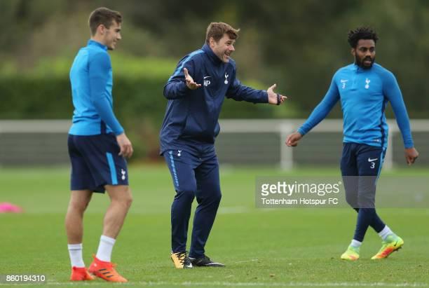 Tottenham manager Mauricio Pochettino with Harry Winks and Danny Rose during the Tottenham Hotspur training session at Tottenham Hotspur Training...