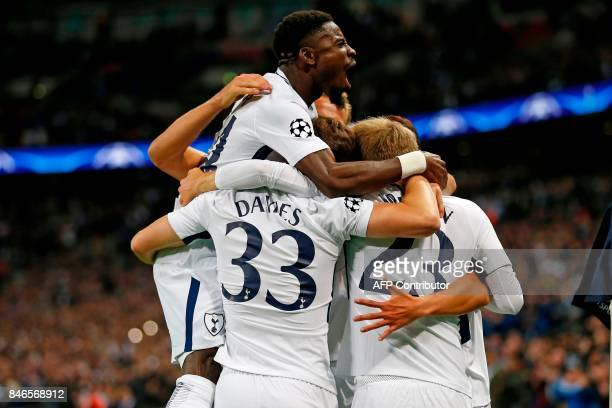 Tottenham players celebrate the opening goal during the UEFA Champions League Group H football match between Tottenham Hotspur and Borussia Dortmund...