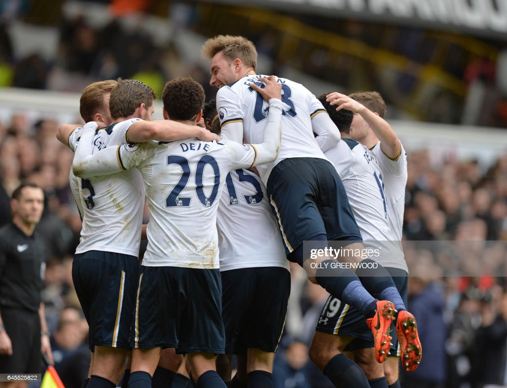 Tottenham players celebrates with Tottenham Hotspur's English striker Harry Kane after he scored his third goal to complete his hattrick during the English Premier League football match between Tottenham Hotspur and Stoke City at White Hart Lane in London, on February 26, 2017. / AFP / OLLY GREENWOOD / RESTRICTED TO EDITORIAL USE. No use with unauthorized audio, video, data, fixture lists, club/league logos or 'live' services. Online in-match use limited to 75 images, no video emulation. No use in betting, games or single club/league/player publications. /