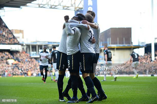 Tottenham players mob Danish midfielder Christian Eriksen as he celebrates after his shot was defelected by West Bromwich Albion's Northern Irish...