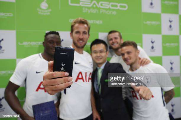 Tottenham players Victor Wanyama Harry Kane Eric Dier and Kieran Trippier take a selfie with CEO Johnson Zhuang of Leagoo during the Tottenham...
