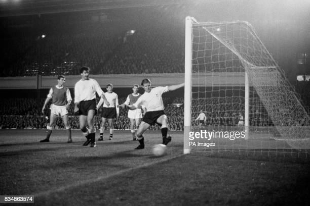 Tottenham right back Peter Baker turns a Johnny MacLeod shot just past the post for a corner Left to right Geoff Strong of Arsenal Maurice Norman...