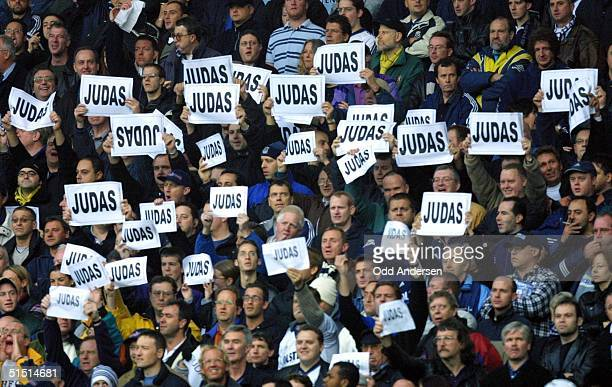 Tottenham Spurs supporters shout abuse at former Spurs player Sol Campbell and teammates warming up for a premier league match at White Hart Lane in...