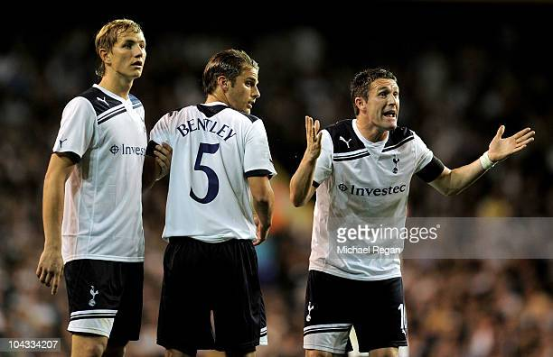 Tottenham teammates Robbie Keane David Bentley and Roman Pavlyuchenko form a defensive wall during the Carling Cup third round match between...