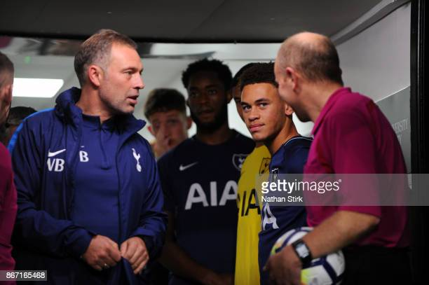 Tottenham Under 21 manager Wayne Burnett and Luke Amos look on in the tunnel during the Premier League 2 match between Derby County and Tottenham...