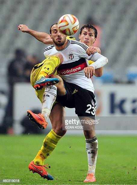 Tottenham's Benjamin Stambouli vies for the ball with Besiktas' Cenk Tosun during the UEFA Europa League Group C football match Besiktas vs Tottenham...