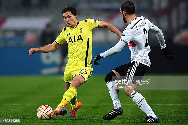 Tottenham's Benjamin Stambouli vies for the ball with Besiktas' Serdar Kurtulus during the UEFA Europa League Group C football match Besiktas vs...