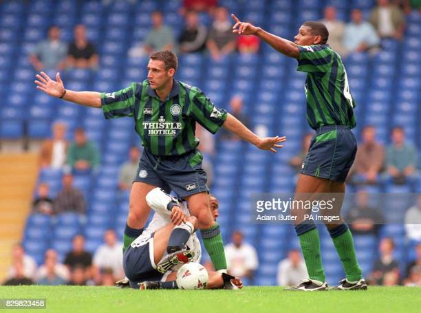 Tottenham's Chris Armstrong gets in a tangle with Leeds' John Pemberton as Carlton Palmer gestures to an official during this afternoon's Premier...