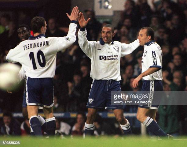 Tottenham's Chris Armstrong is confgratulated by teammate Teddy Sheringham after scoring against Hereford during the FA Cup thvird round replay match...